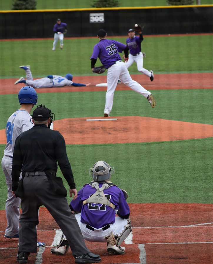 Junior+catcher+Brent+Feldner+looks+on+as+freshman+pitcher+Brett+Smerz+attempts+a+pick-off+play+to+senior+second+baseman+Steve+Chamberlain+against+Concordia+University.+UW-W+fell+21-3.+Photo+by+Hannah+Jewell%0A