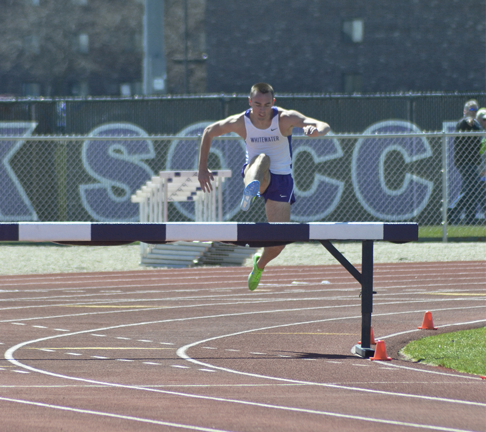 Junior Brett Harms leaps over a hurdle in the Rex Foster Invitational. Photo by Sierra High