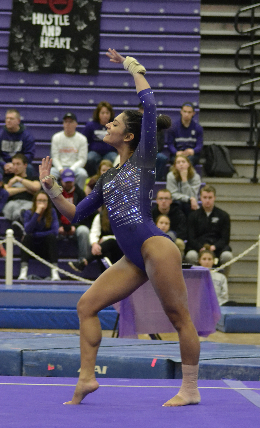 Sophomore all-around champion Lisa O'Donnell poses during her floor routine at a home meet earlier this year. Photo by Sierra High
