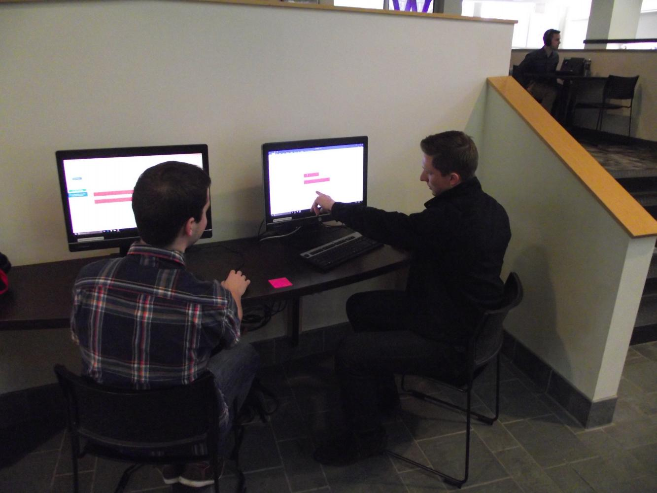 Seniors Jacques LaReau and Trevor Beckmann sift through vaccination research together in the UC.