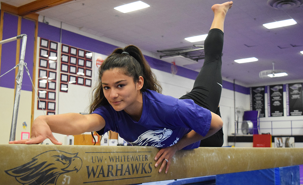 Sophomore+Lisa+O%27Donnell+poses+on+the+balance+beam+after+winning+the+Royal+Purple+Female+Athlete+of+the+Year.+Photo+by+Hannah+Jewell