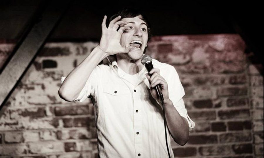Samuel Comroe performs his signature stand-up