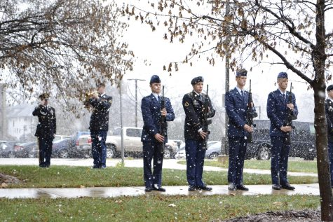 A gun salute and taps honor veterans on Nov. 11 during a ceremony outside the Hamilton Room.