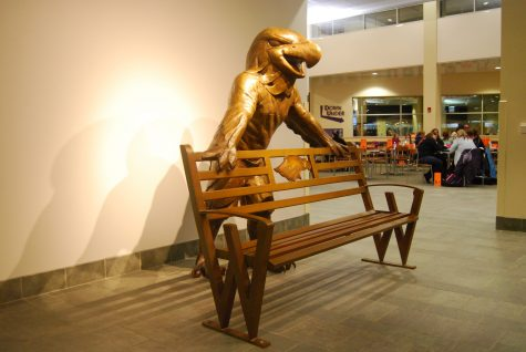 The life-size sculpture of Willie the Warhawk leans on the back of an attached bench outside of Beans  coffee shop. The bench cost about $40,000. Funding came from multiple sources, including gift funding.