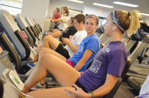 Liz Mielke and Mayzee Hurst talk and work out on the stationary bikes at the William Center.