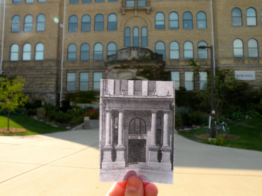 An old photo of the East Wing entrance of Old Main, now known as Hyer Hall, held up to the current building entrance.
