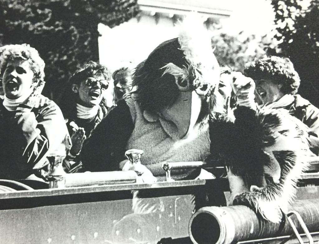 Willie the Warhawk (1970s) cheers with a crowd of students in an early version of the mascot costume. The current suit Willie the Warhawk wears was custom made to resemble the university logo. Photo Submitted.