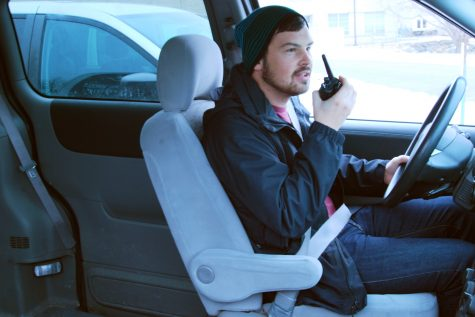Senior Kyle Crossett talks to dispatch on the two-way radio as he gets ready to go on a pick-up. Vesna Brajkovic photo/ BrajkoviVA04@uww.edu