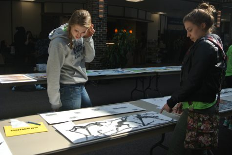 Students look over long-term projects