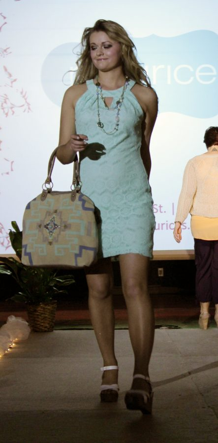 A Maurices model shows a mint lace dress, simple accessories, strappy wedges and bold patterned handbags for their spring fashion runway debut.