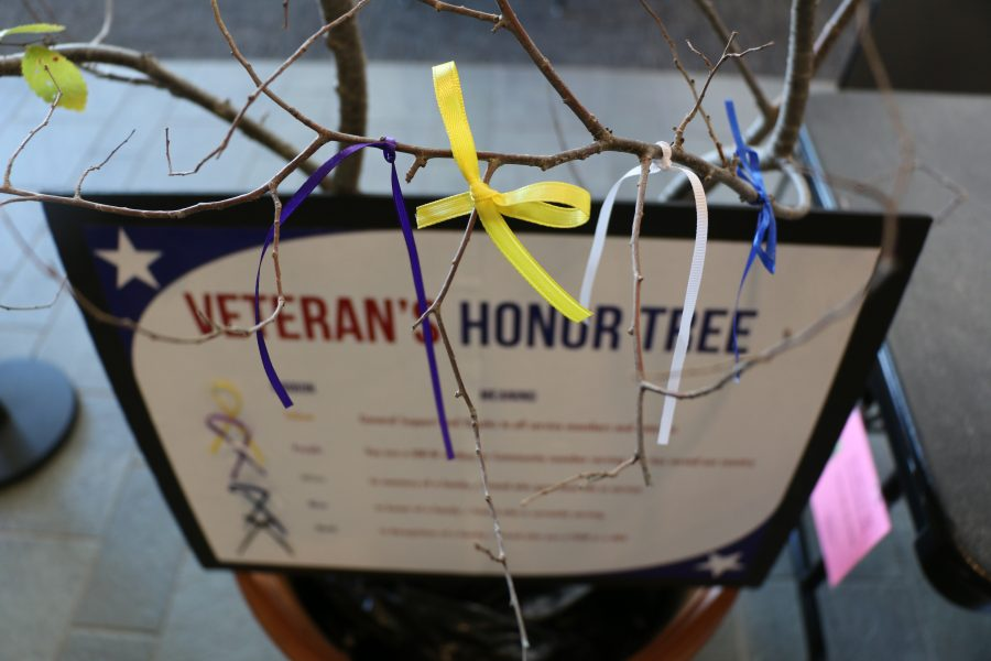 The Veteran Honor Tree is on display in the University Center. Members of the University of Wisconsin- Whitewater community are able to tie various ribbons to the tree that represent different service members. The tree went up Nov. 9 and will be available until Nov. 13.  Photo by Amber Levenhagen