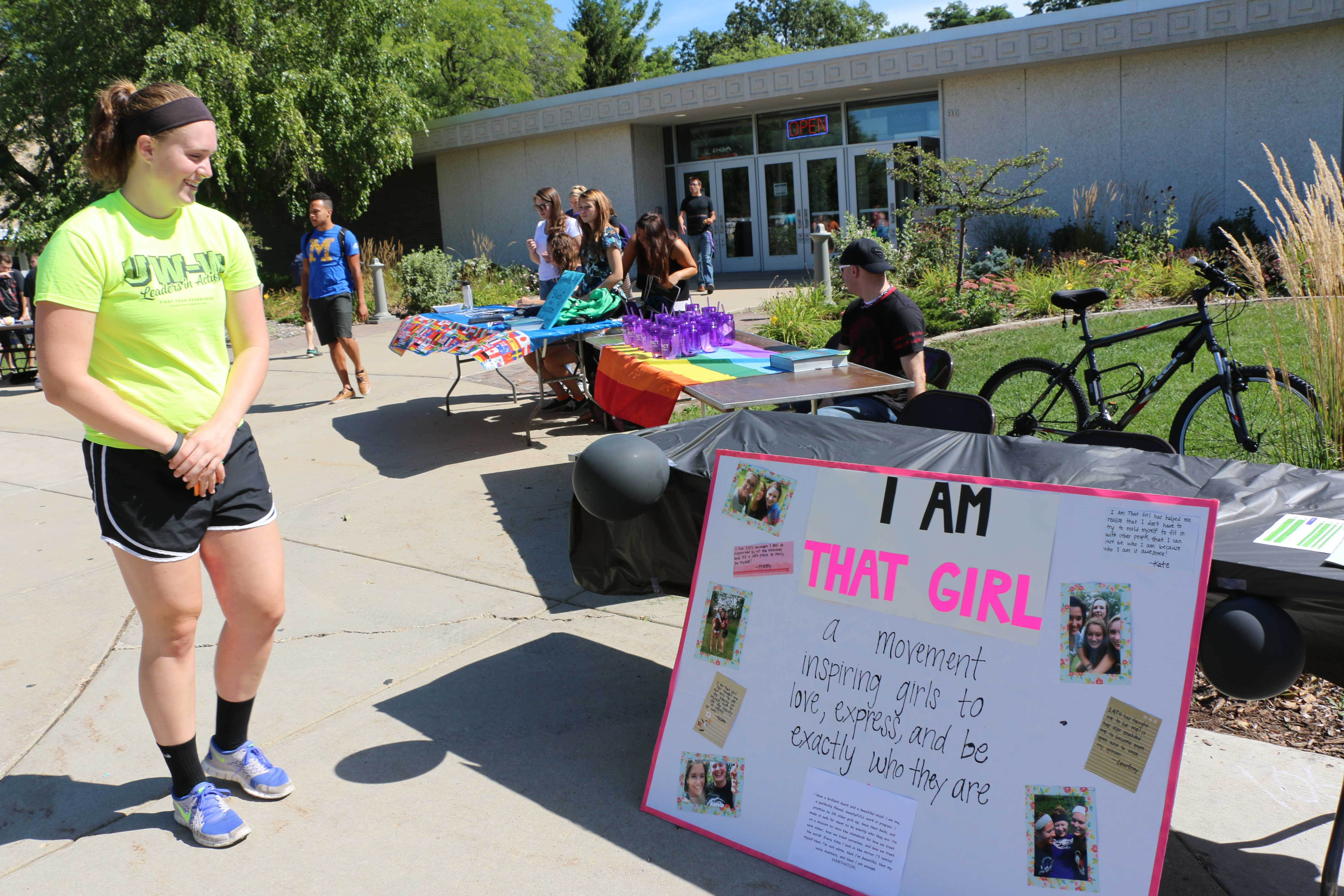 Junior biology major Kaitlyn Mckay discovers the I Am That Girl table at the Involvement Fair held Sept. 9 on the Wyman Mall. I Am That Girl had 104 women show interest in their chapter at their first appearance at the fair.  Photo by Amber Levenhagen