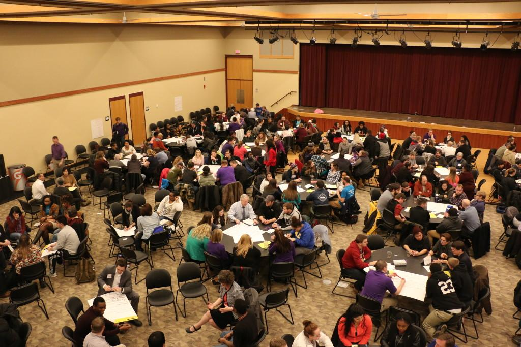 Attendees of the forum sit together in groups to discuss solutions for UW-Whitewater's campus climate issue. The room had been much fuller at the beginning of the event where students and faculty were encouraged to share their stories – close to 430 people were there.