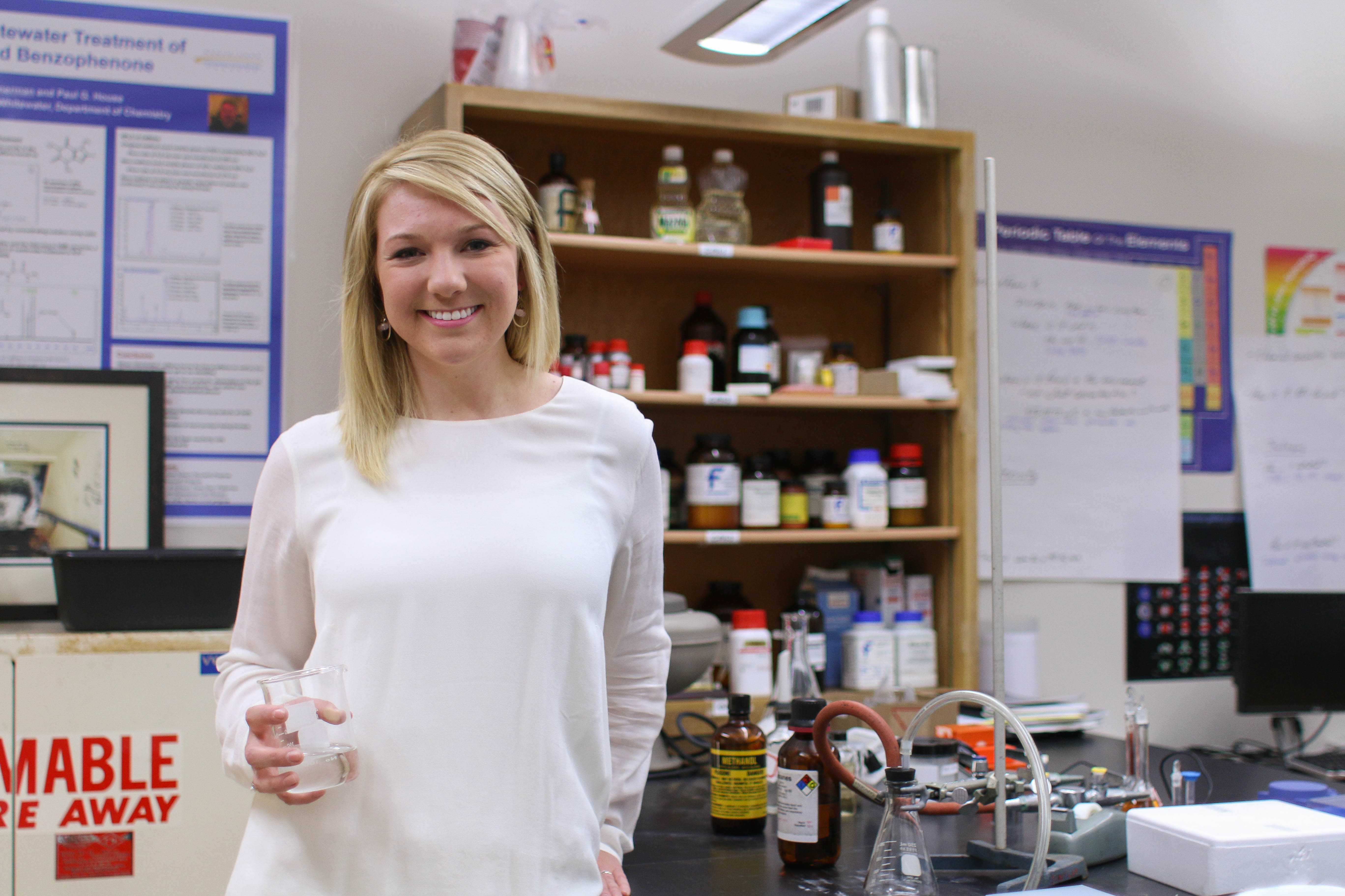 Biology major Lauren Kats holds a beaker in an Upham Hall chemistry lab, where she did her work as an undergraduate researcher. Kats is set to speak at UW-Whitewater's undergraduate commencement on May 14. Commencement will be divided between undergraduate and graduate degrees. Photo by Kimberly Wethal.