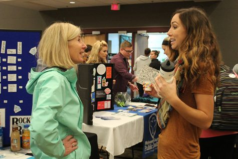 Kristin Wallace, Executive Director of Rock River Free Clinic, discusses student wellness with Cassie Benner, a representative for WellHawks at the Wellness Fair on Wednesday Oct 12. WellHawks is a student wellness organization on campus.  photo by Kim Gilliland