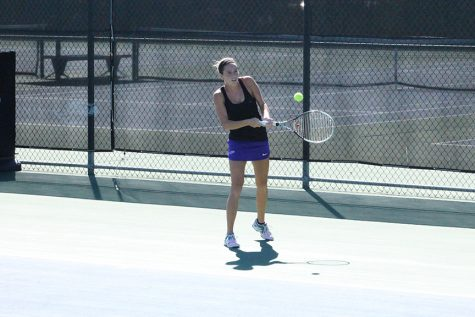 Senior Megan Humphreys returns a shot at the Warhawk Invite on Sept. 3. Photo by Kim Gilliland