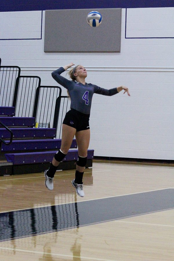 Junior defensive specialist Shelby Clifton serves the ball in a  Warhawks victory against Edgewood College on Sept. 17. Photo by: Kim Gilliand
