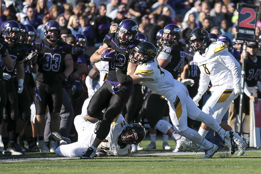 Sophomore+running+back+Drew+Patterson+sheds+multiple+tacklers+on+a+run+in+the+17-14+victory+against+UW-Oshkosh.+Patterson+carried+the+ball+20+times+for+90+yards+and+a+touchdown.+Photo+by+Kimberly+Wethal
