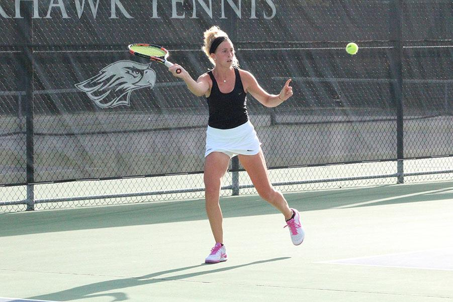 Junior Gabriella Gregorio returns a shot in a meet from earlier this year. Although no team scores were kept, UW-W still notched many victories at the ITA Midwest Regional Championships. Photo by Kim Gilliland