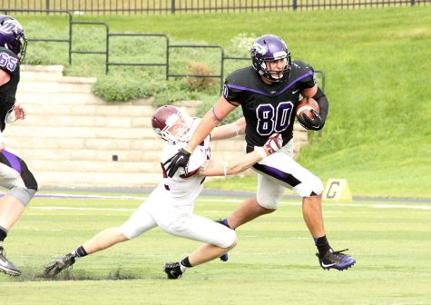 Junior tight end Tony Gumina sheds a tackler in UW- Whitewater's victory against Morningside College on Sept. 24. Gumina caught a team-high five passes for 39 yards in the 30-24 road victory against No. 5 UW-Platteville on Oct. 1 in the WIAC opener. Photo by Kim Gilliland, graphic by Carlie Sue Herrick