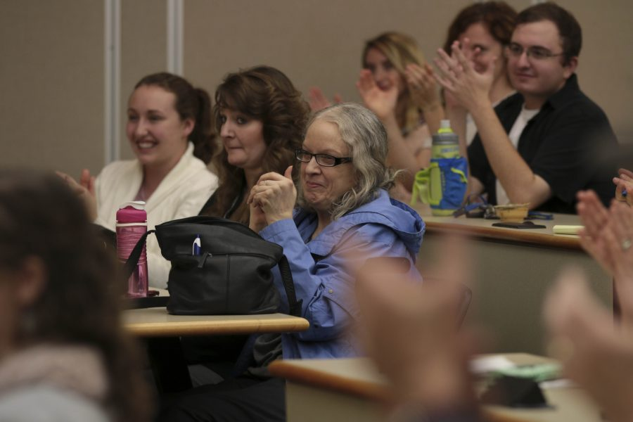 Students and Community members applaud Feingold after sharing his stances on issues like healthcare and immigration.
