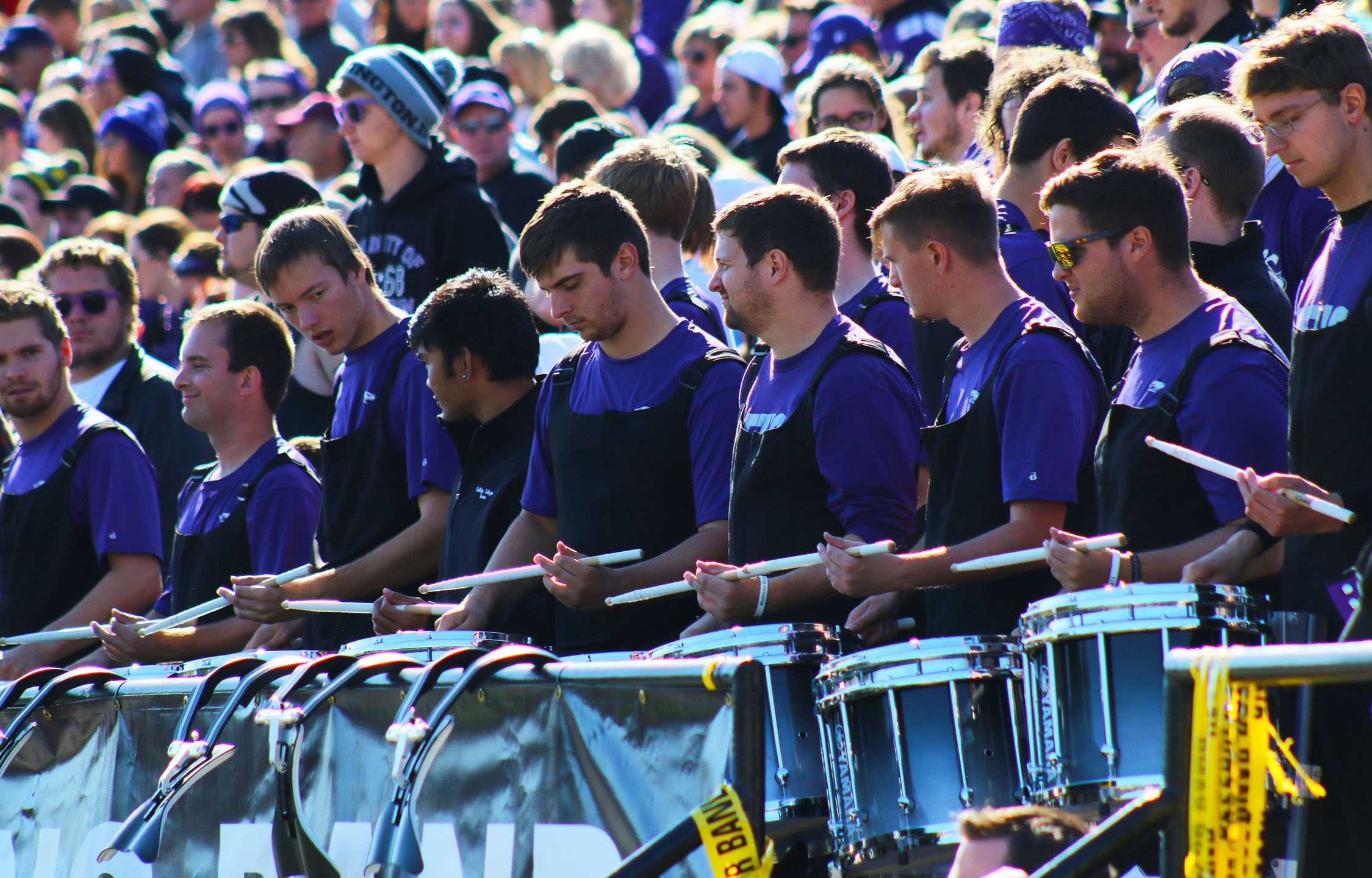 The UW-W Snare line plays to cheer on the Warhawks at the Homecoming football game on Sat. Oct. 22. The Line plays on Yamaha drums, the company who endorsed them for their level of excellence.
