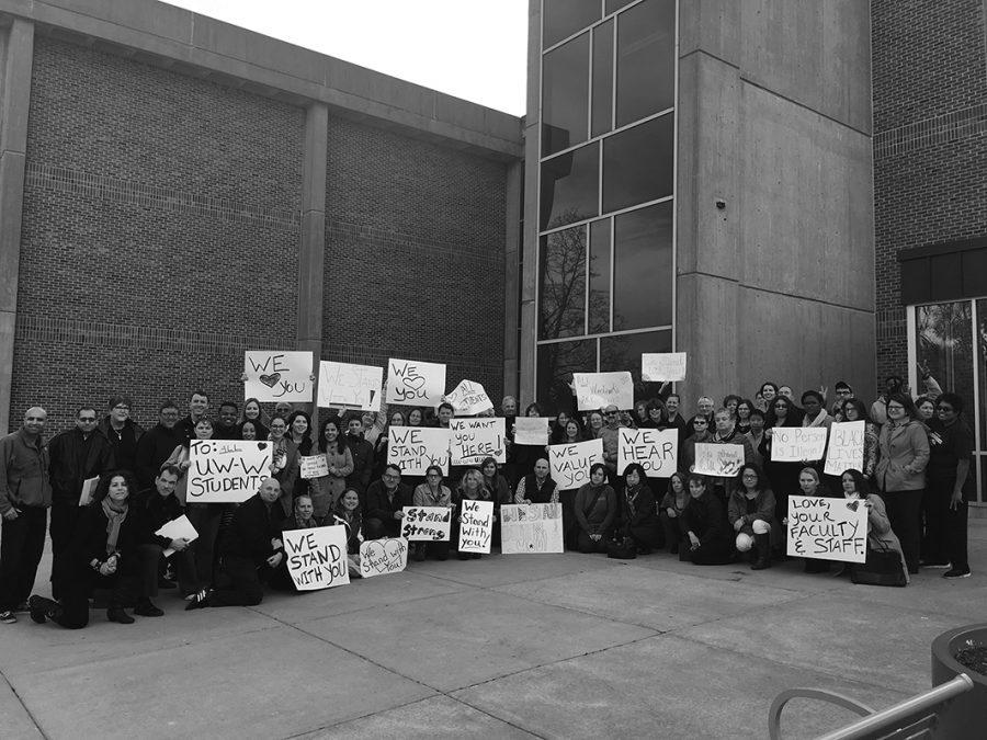 University of Wisconsin-Whitewater Professors and Staff march and hold signs outside of Winther Hall, showing that they are standing in uniformity with students, after hearing fears from students and other staff following the election.
