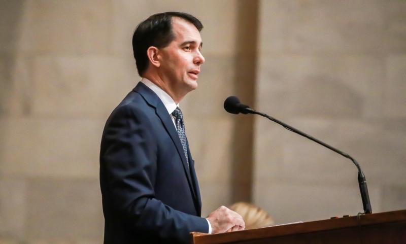 "Gov. Scott Walker gives his State of the State address to Wisconsin legislators earlier this month. With a theme of ""working and winning for Wisconsin,"" Walker announced plans for a third UW tuition freeze and an unspecified cut for in-state students for the '17-19 state biennial budget during his address."