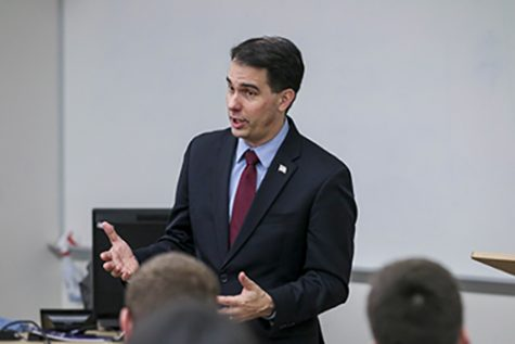 Scott Walker speaks to a full room of students to kick of the first UW College Republicans meeting of the spring semester. Walker focused on economic issues that face college students as well as Wisconsin.