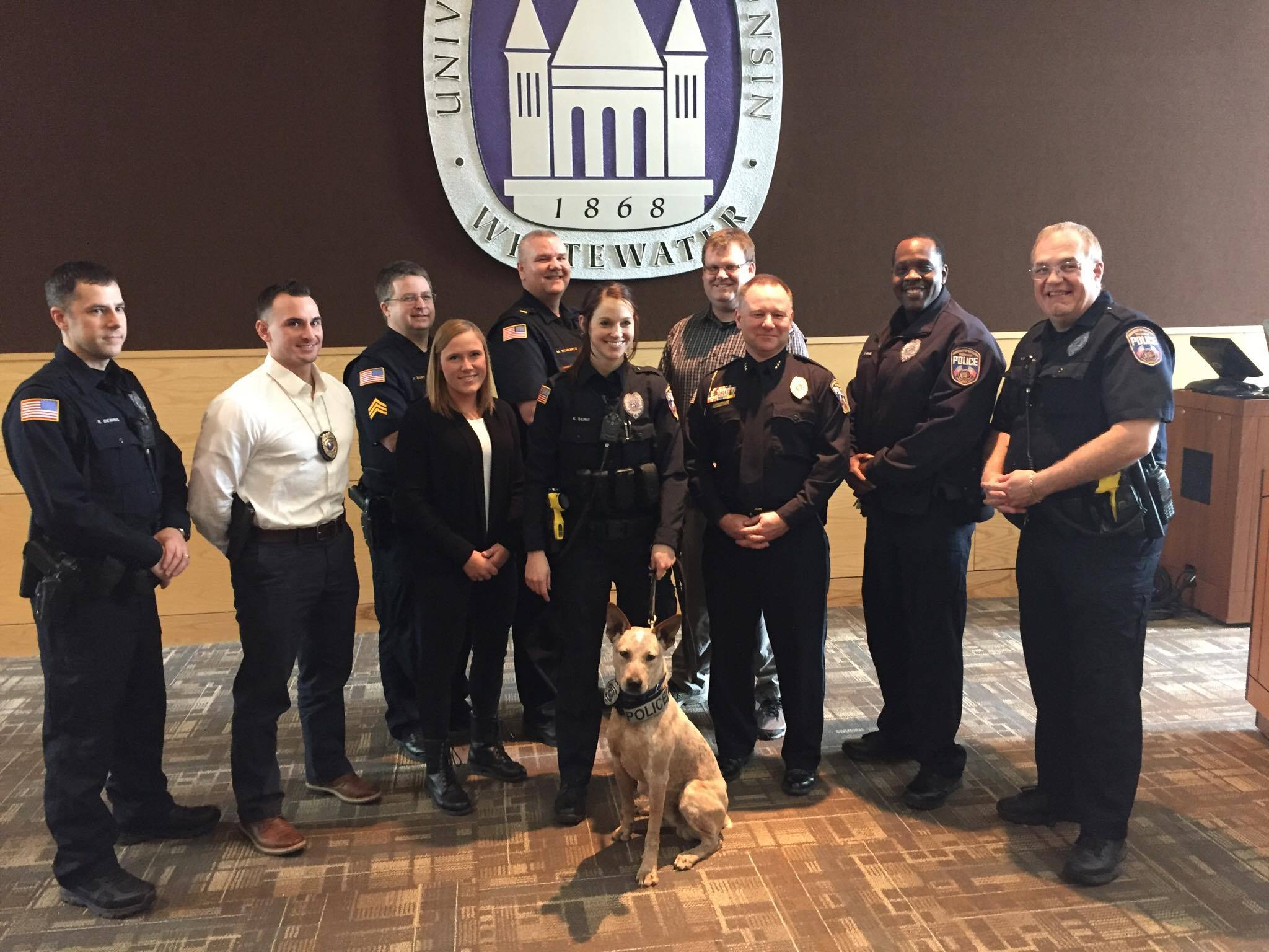 Hawk, with assistance from his partner, officer Kelsi Servi, left his inked paw-print on his official inauguration certificate at his swearing in ceremony on Feb. 1. Members of Police Services joined Hawk as he became a member of their task force.