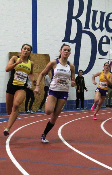 UW-Whitewater+Track+Athletes+cheer+of+junior+Celeste+Madda+on+the+final+turn+to+win+the+200+meter+dash+at+the+WIAC+Conference+Championship+February+25%2C+2017.+%28Erika+Sternard%29