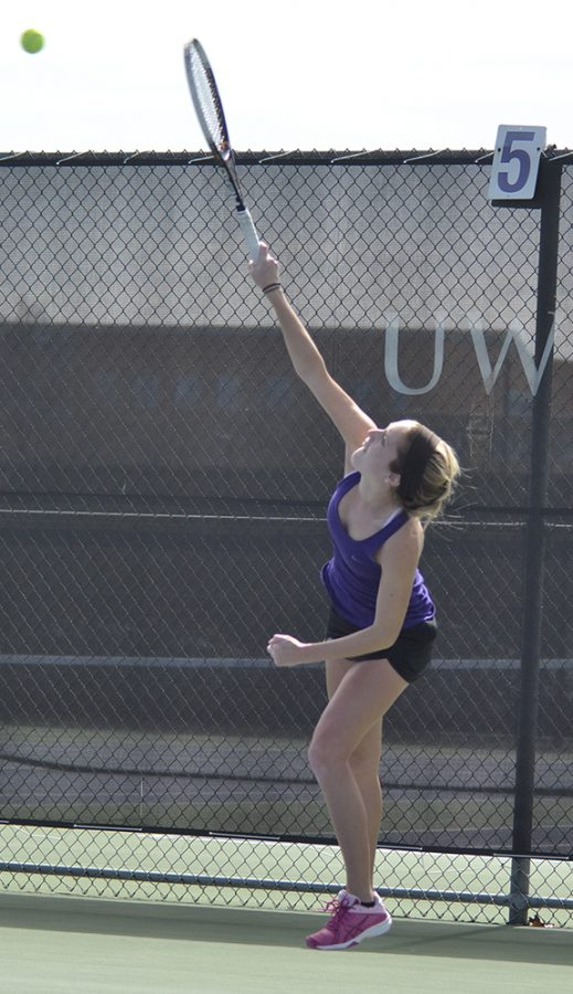Senior+Megan+Humphreys+serves+the+ball+in+an+April+1+tennis+match.+Humphreys+was+undefeated+that+day.+Photo+by+Sierra+High