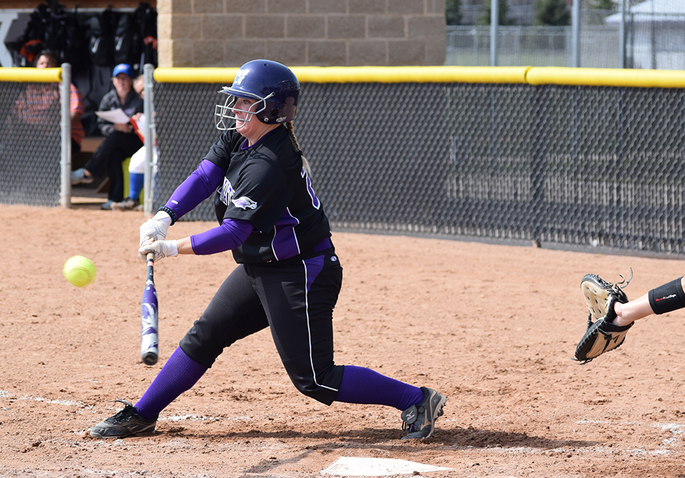 Senior first baseman Amy Ricci connects for a hit in a game earlier this season. Ricci hit an RBI single in the second game vs. Carroll University on April 20. Photo by Hannah Jewell