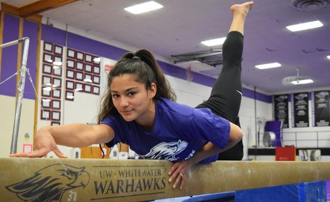 Sophomore Lisa O'Donnell poses on the balance beam after winning the Royal Purple Female Athlete of the Year. Photo by Hannah Jewell