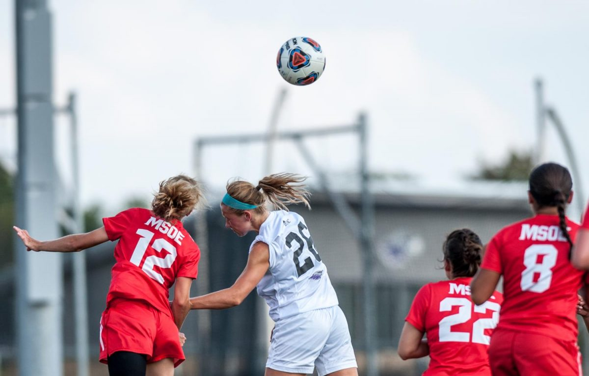 Junior defender Payton DeLuga goes up for a header against MSOE. DeLuga recorded one assist during the game and anchored a Warhawk defense that only allowed one shot on goal all game.