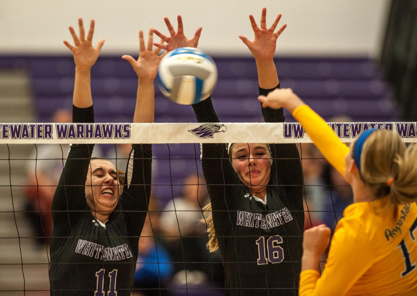 Senior+middle+hitter+Courtney+Wagner+%2811%29+and+sophomore+outside+hitter+Rachel+Butterfield+%2816%29+team+up+for+a+block+against+Augustana.+Wagner+led+the+Warhawks+with+eight+blocks+and+was+one+of+two+Warhawks+to+make+the+All-Tournament+team.+She+was+joined+by+junior+libero+Brittany+Robinson