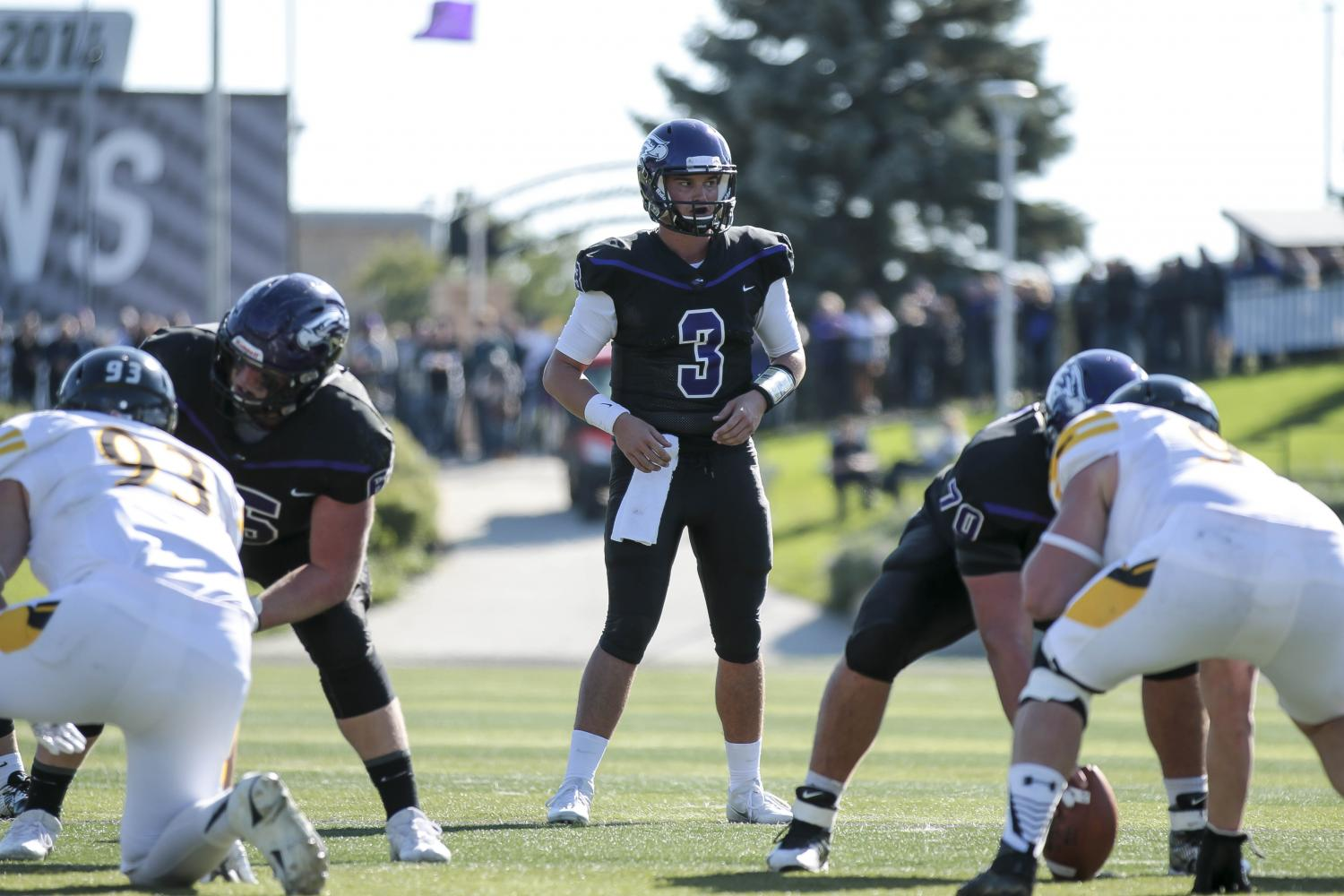 Quarterback Cole Wilber awaits a snap. The quarterback-center exchange was one of the Warhawks biggest issues in the season opener against IWU.