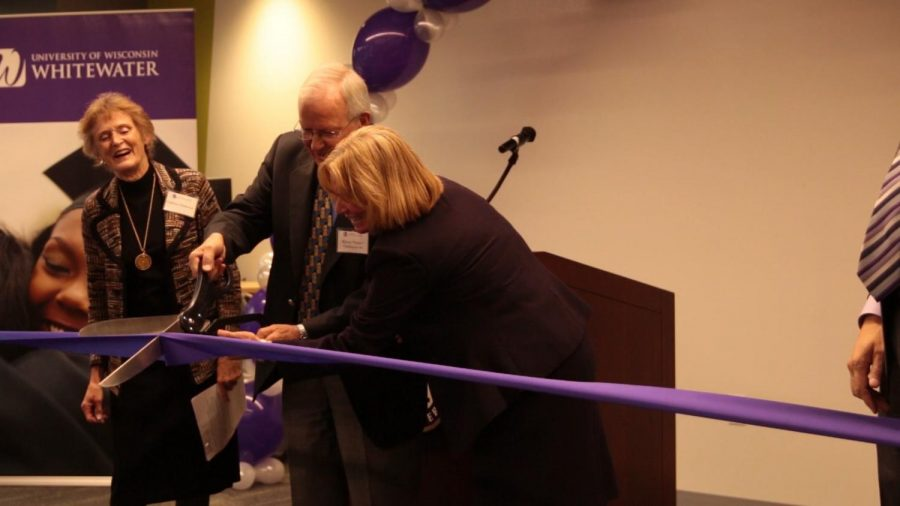 "Chancellor Beverly Kopper and Byron ""Chris"" Chrisman, the benefactor for the Mary Poppe Chrisman Success Center cut the ribbon to officially open and dedicate the building on Friday, Oct. 13."