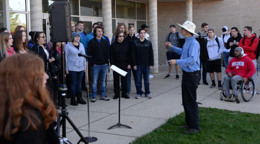 """Concert choir students perform """"diversity genre pieces"""" on the lawn of the UC Mall for fellow UW-Whitewater students and staff."""