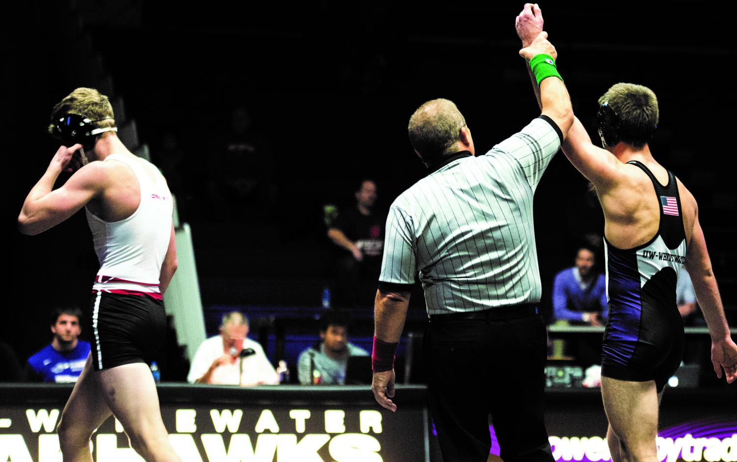 The referee raises sophomore Wilder Wichman's hand after his 7-2 decision victory over the Badger's Patrick Spray at 149 pounds. Wichman was the only Warhawks' wrestler to claim a victory in his match against the UW-Madison wrestling squad.