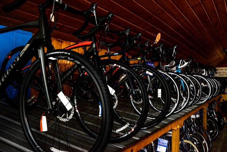 Some bicycles in the Sotherland Custom shop are hanging in the back of the BicycleWise store. John Sotherland has been working with bicycles for nearly 40 years. He launched BicycleWise in 2001.