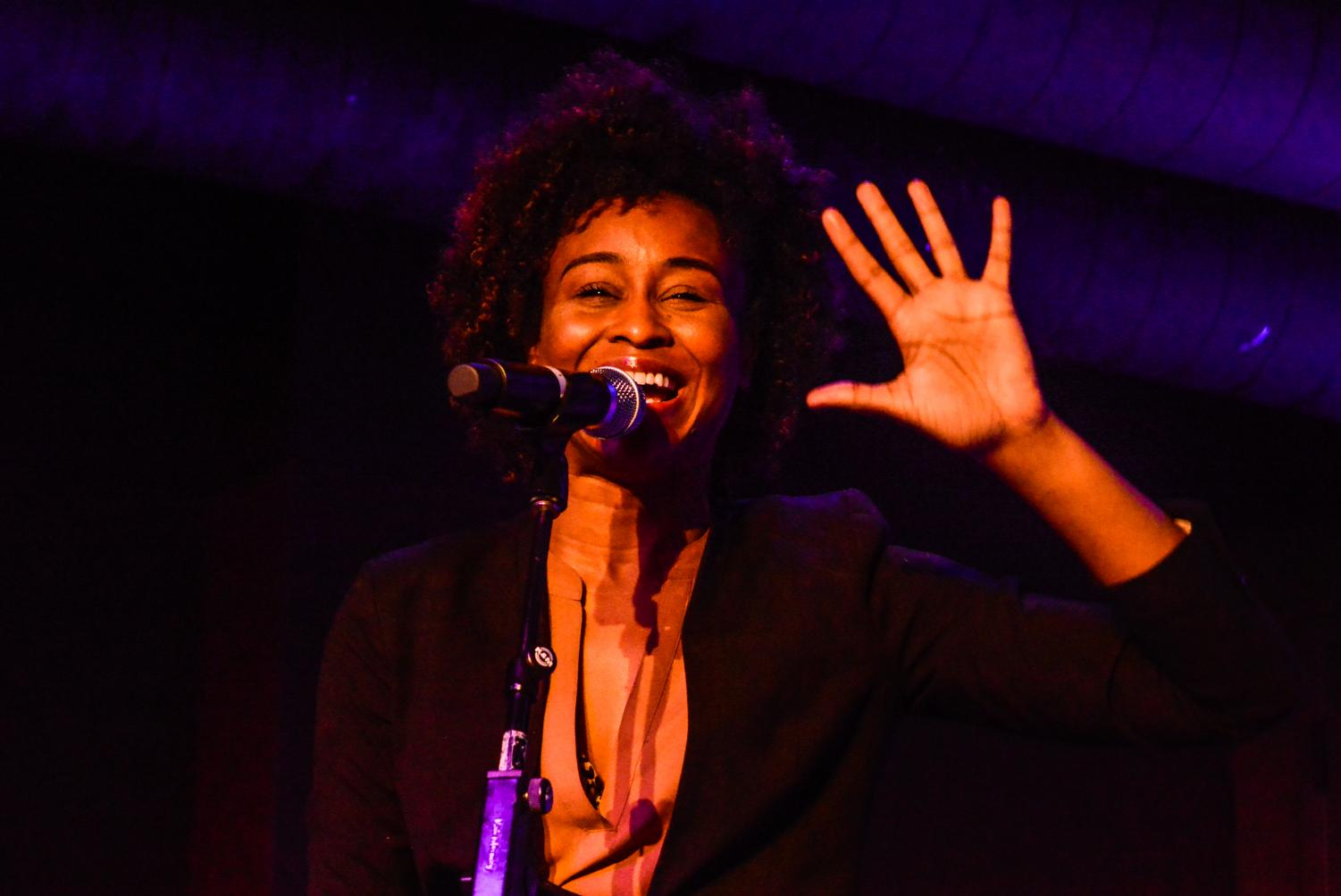 Poet Kyla Lacey performs her work on Feb. 22 at the Down Under in the University Center.