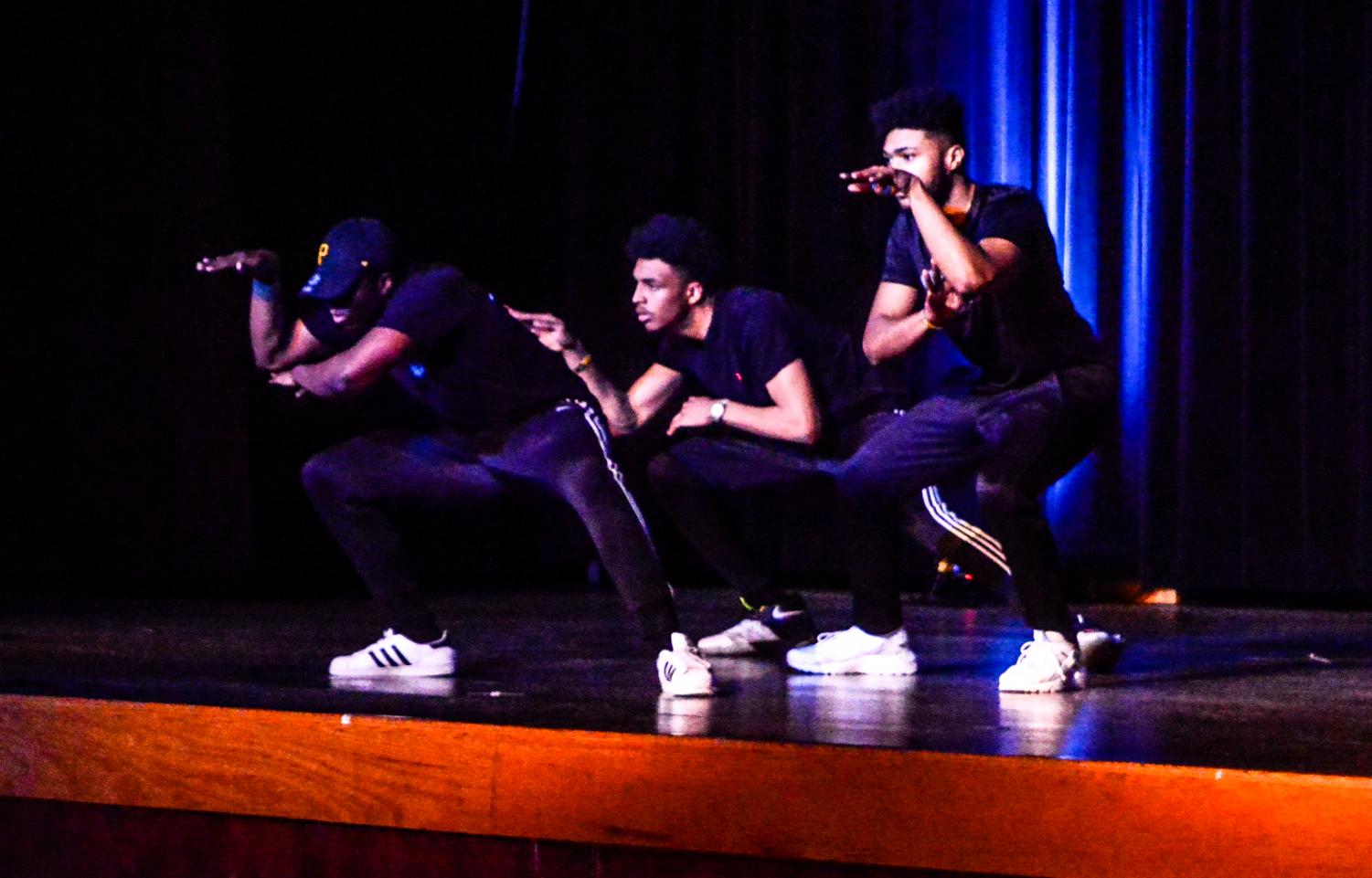 Students of Alpha Phi Alpha fraternity show pride for their Greek organizations at an annual talent show during Greek Week on Feb. 22 in the University Center Hamilton Room.