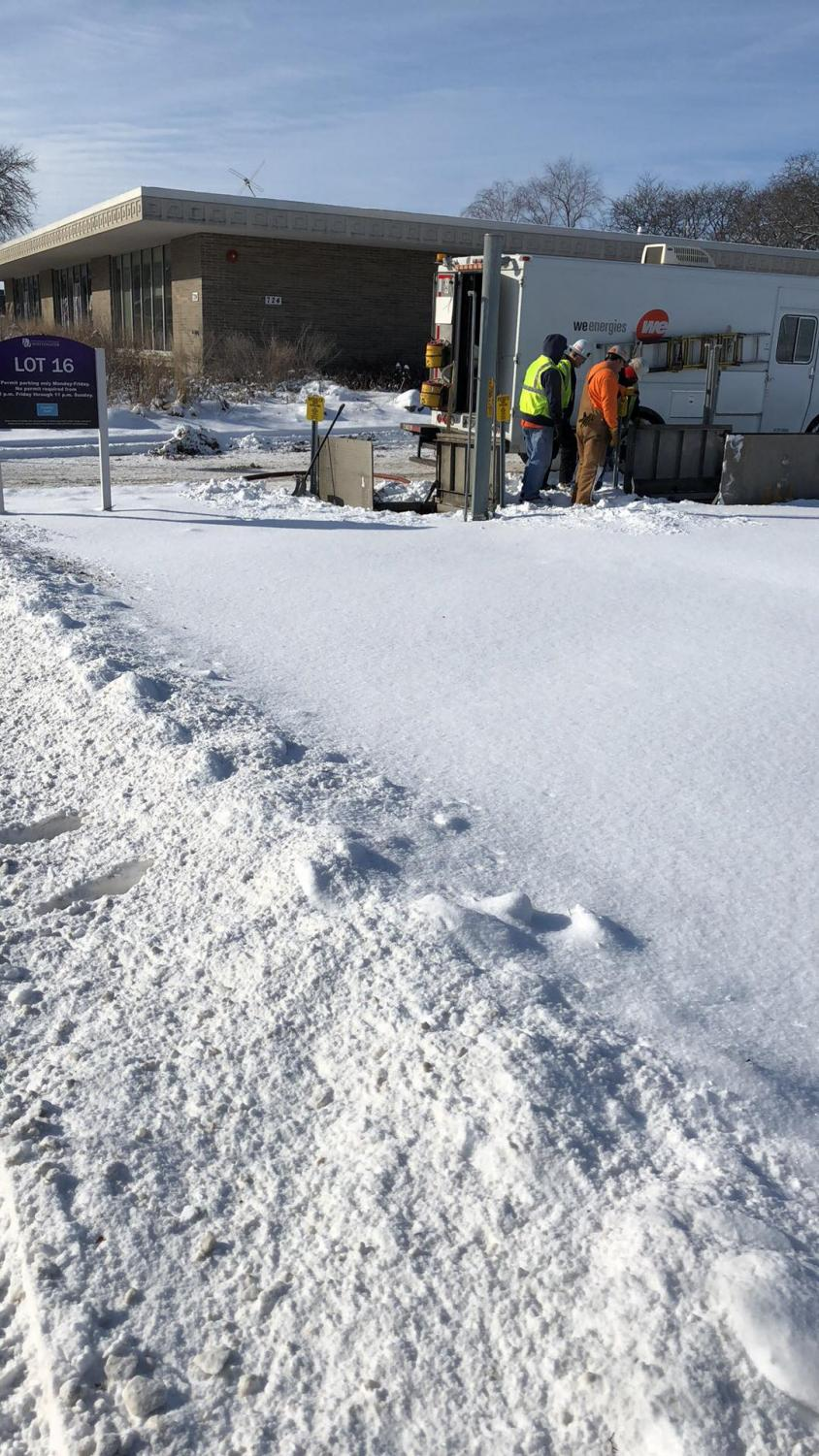 Crews from WE Energies survey the scene of a gas leak as they work to fix the issue Tuesday, Feb. 6.