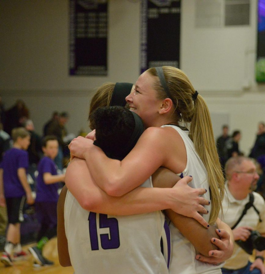 Teammates senior guards Brooke Trewyn, Malia Smith and senior forward Andrea Meinert embrace after pulling out a win over the UW-Oshkosh Titans on Feb. 24 to clinch the WIAC championship title for the first time in program history. When the three started their UW-W basketball in the 2014-15 season, the team had a record of 13-13. The win propels them to the NCAA D-III tournament. The team's seeding was not released by press time.