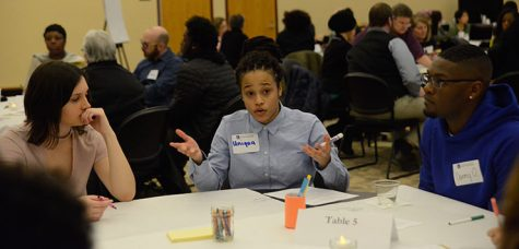 "Freshman Uniqua Woodson talks with fellow students about what the University of Wisconsin - Whitewater can do to improve diversity and foster an inviting environment on campus at ""Shaping Our Future Through Civil Dialogue."