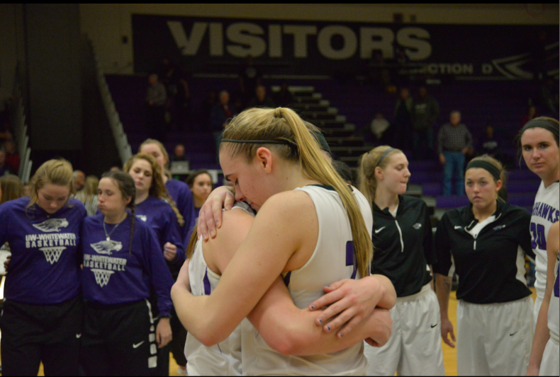 Junior forward Olivia Freckmann embraces a teammate after the women's basketball team was defeated by Gustavus Adolphus in the second round of the NCAA Division III Tournament. Freckmann finished the game with 12 points and five rebounds.