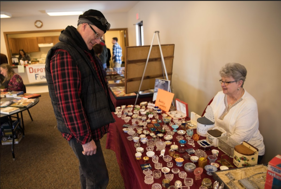 From left, Scott Wild inquires about Bobby Landsee's collection of salt cellars, which were used in the Victorian era because salt was not yet shakeable from salt shakers. Landsee said she has over 1,000 salt cellars that she's collected over the years.
