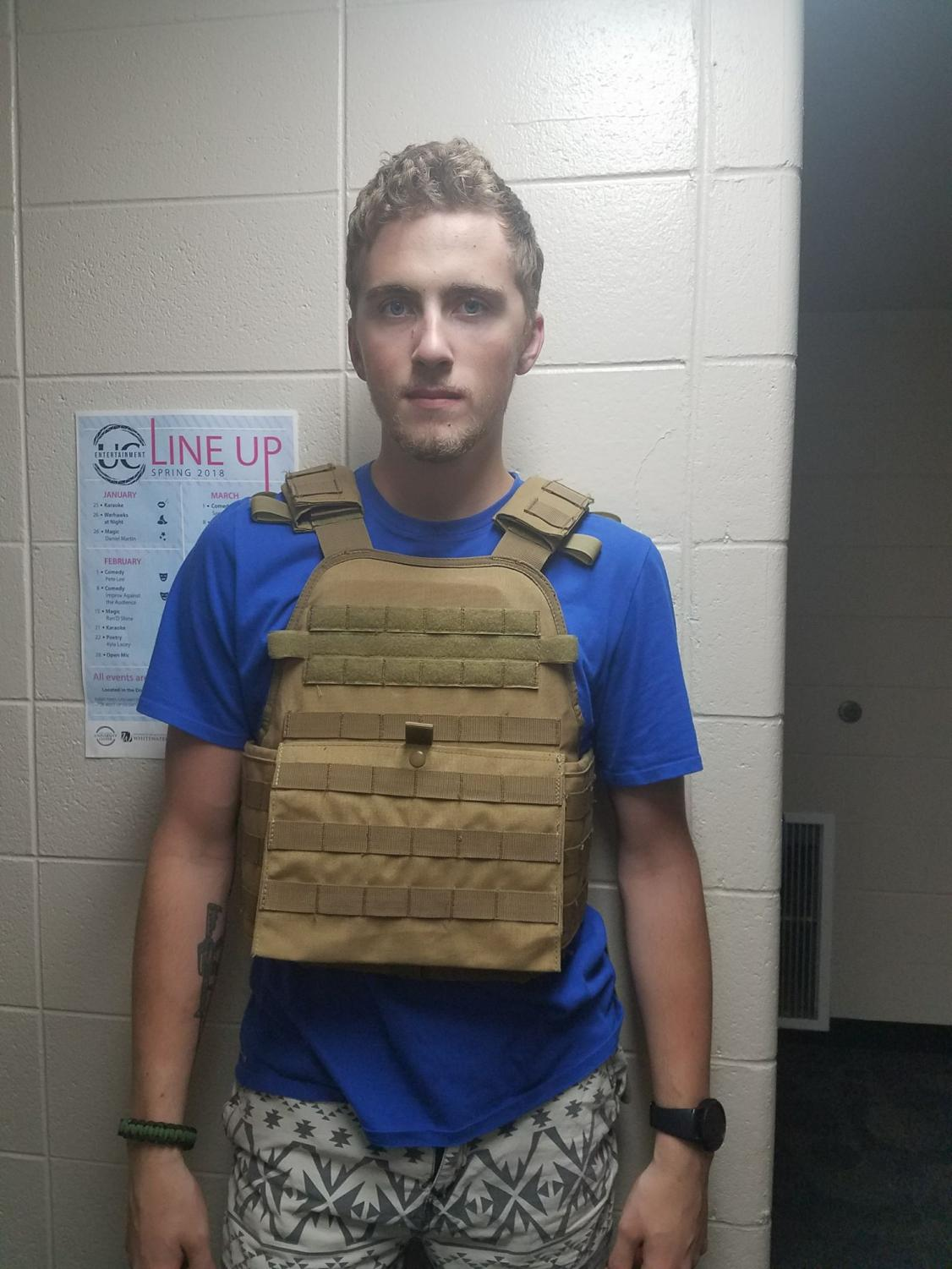Freshman Alex Sindorf wears a bulletproof vest after receiving a campus-wide alert of a potential threat to safety. The alert was accidentally sent out due to a technical error, UW-W Police Services said.