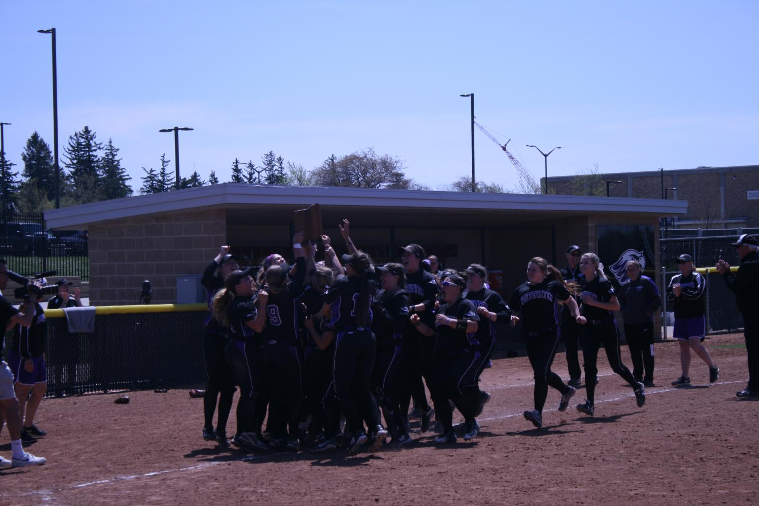 The Warhawks celebrate after recieving the WIAC Championship Tournament trophy for the sixth consecutive season. The six straight tournament championships is the longest streak in conference history.